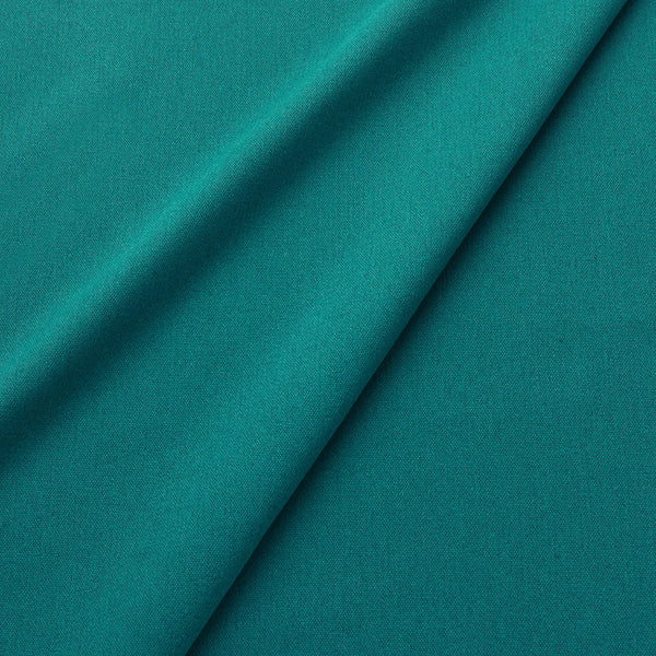 Fabric swatch of a eco-friendly plain teal fabric for curtains and upholstery