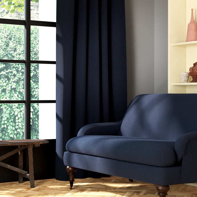 Living room featuring a sofa and curtains in a plain midnight blue eco-friendly fabric