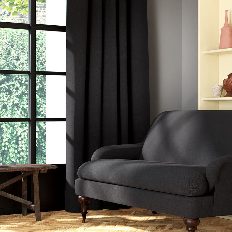 Living room featuring a sofa and curtains in a plain dark grey eco-friendly fabric
