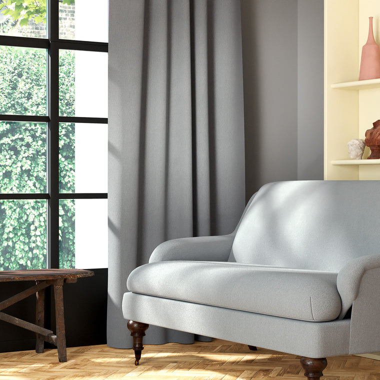 Living room featuring a sofa and curtains in a plain light grey eco-friendly fabric
