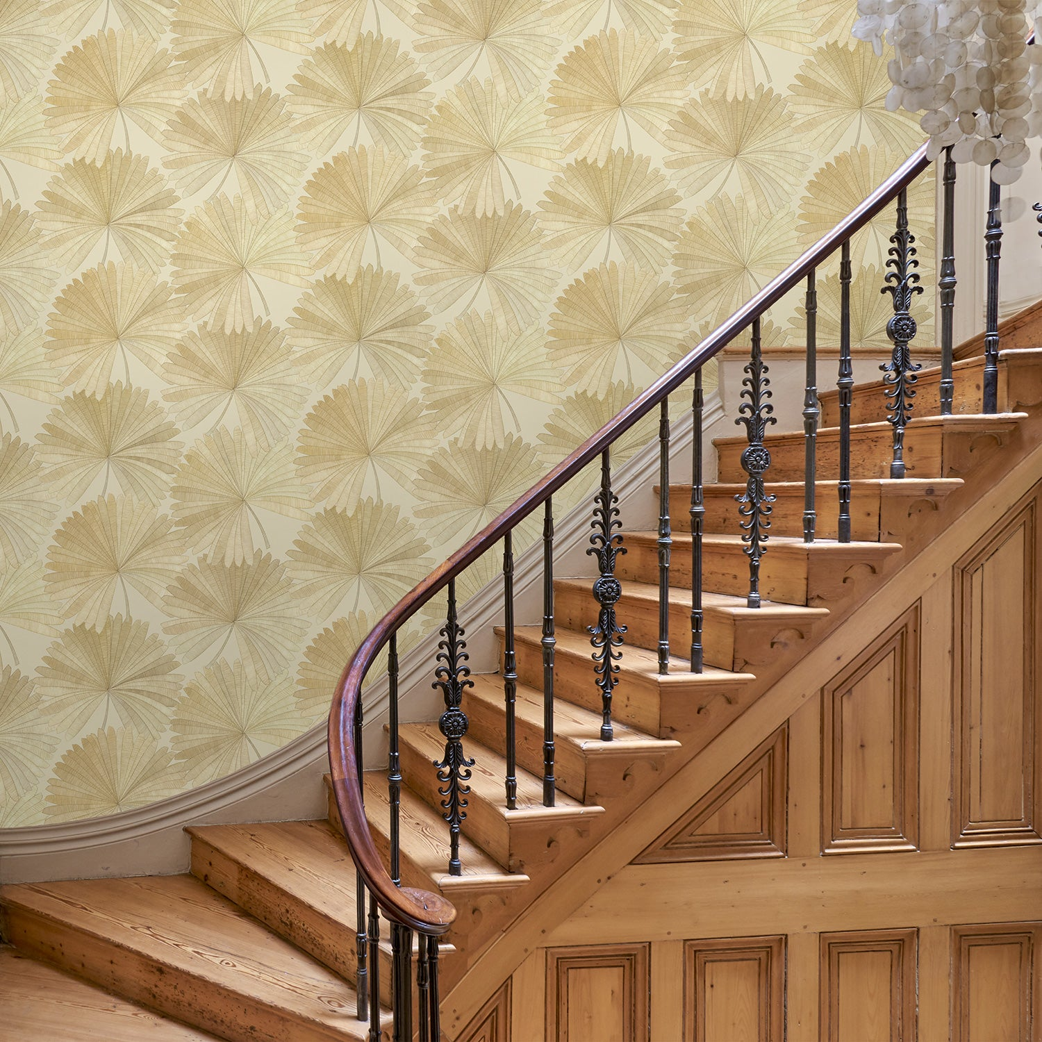 Hallway featuring a Wallpaper in neutral colours with a tropical palm leaf design
