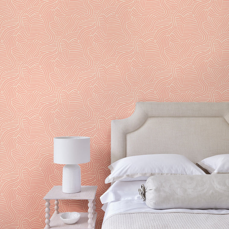 Bedroom featuring a Luxury pink wallpaper with an abstract wave design