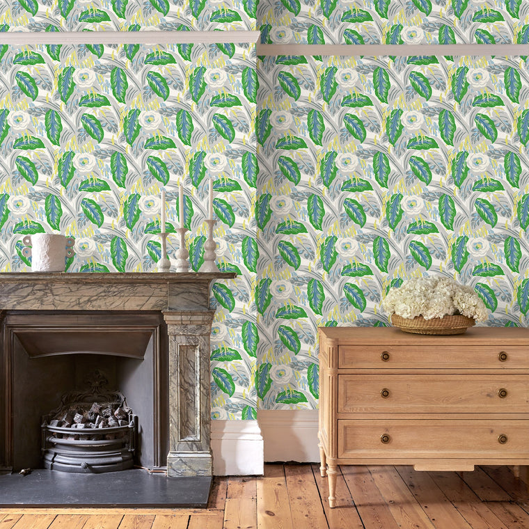 Living room with a luxury designer wallpaper featuring a green floral design