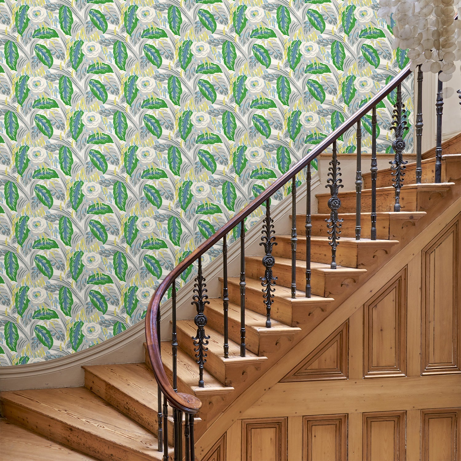 Hallway featuring a luxury designer wallpaper with a green floral design
