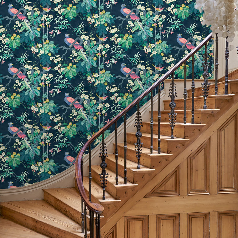 Stairway with a luxury designer wallpaper with a bird and floral design