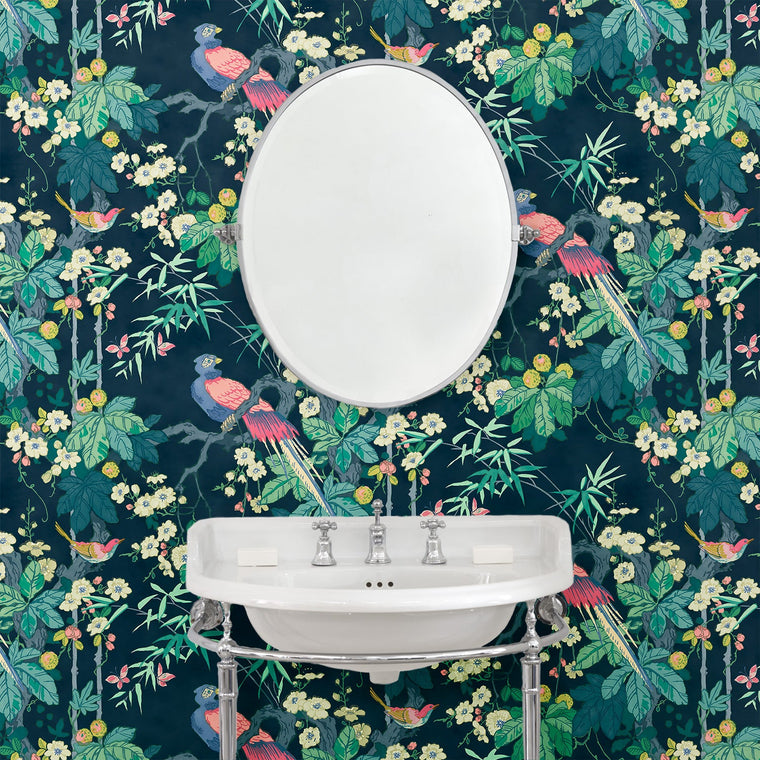 Bathroom with a luxury designer wallpaper featuring a bird and blossom design