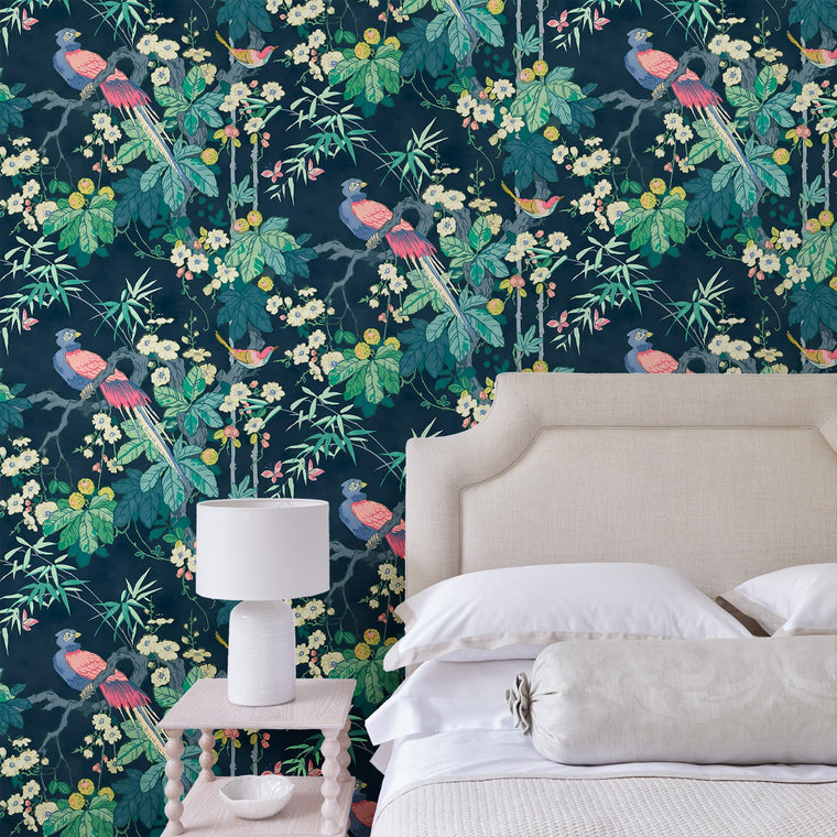 Bedroom featuring a luxury designer wallpaper with a bird and blossom design