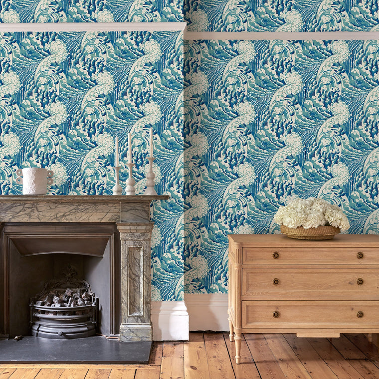 Living room featuring a luxury designer wallpaper with a Hokusai-inspired wave design