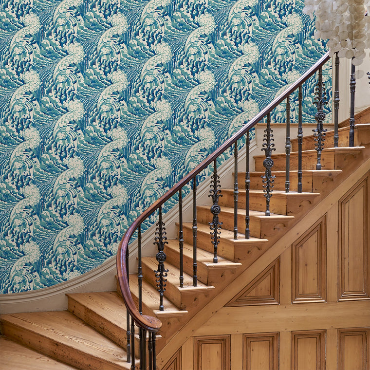 Hallway with a luxury designer wallpaper featuring a Hokusai-inspired wave design