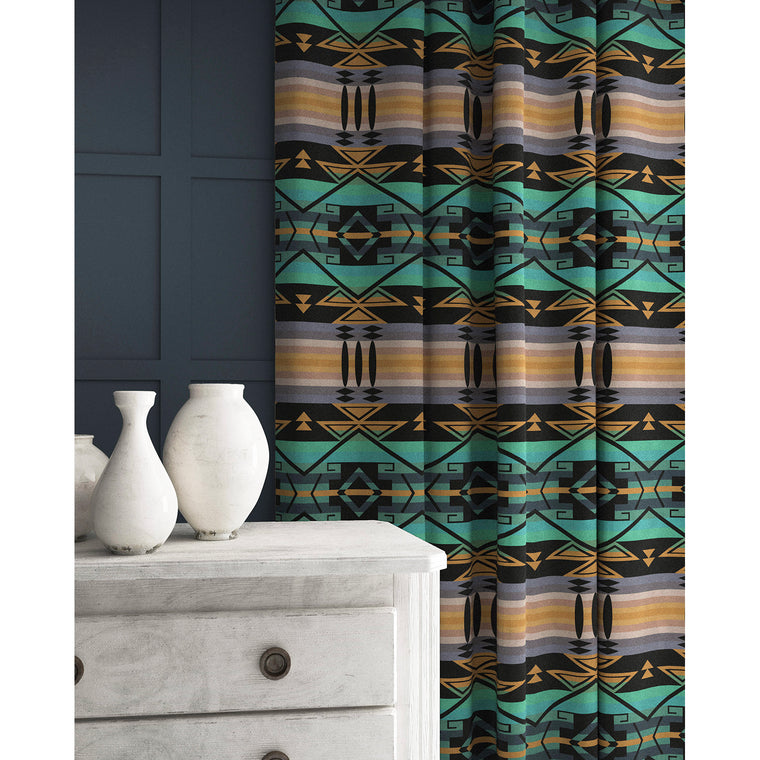 Curtain in a teal and purple coloured wool fabric with South American inspired design