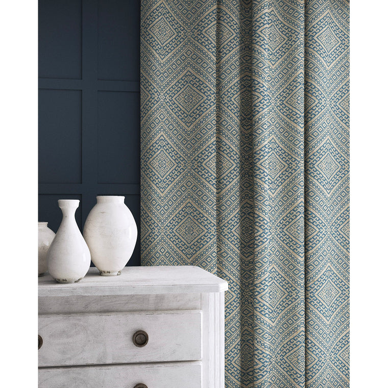 Curtain in a blue and neutral coloured geometric wool weave fabric