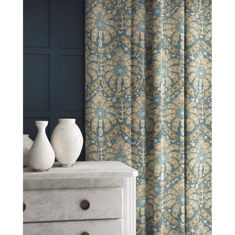 Curtain in a navy and neutral wool fabric with abstract palm design