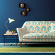 Sofa upholstered in a blue and coral printed wool upholstery fabric with abstract design