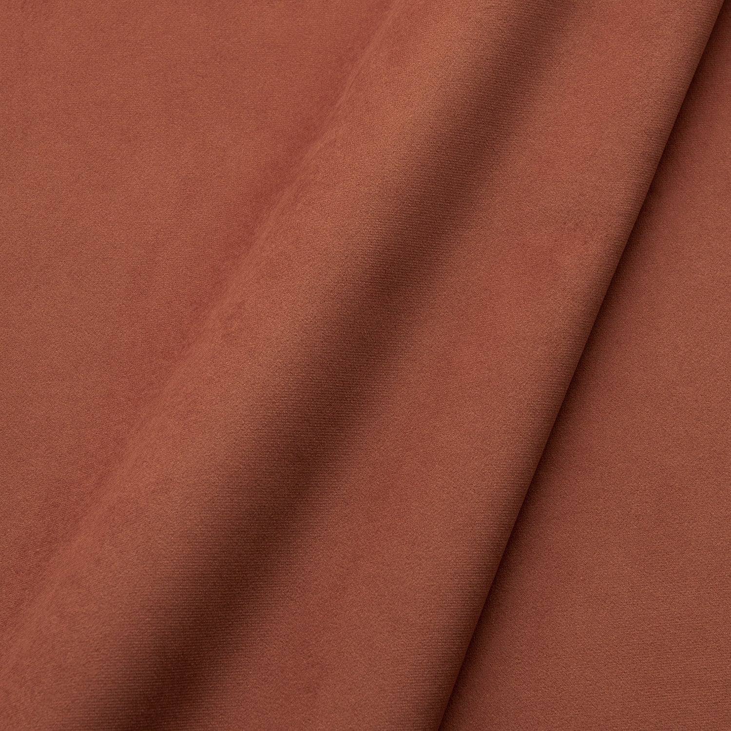 Fabric swatch of a plain stain resistant velvet upholstery fabric in a terracotta colour