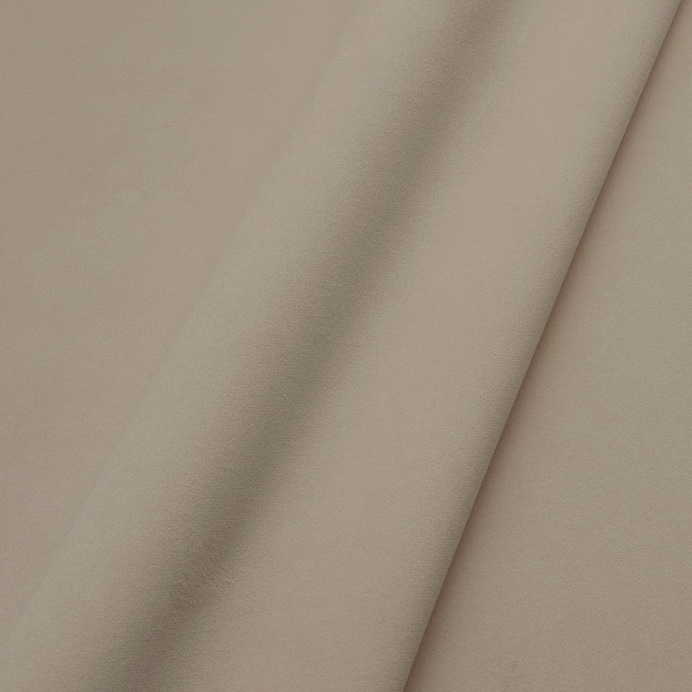 Fabric swatch of a plain stain resistant velvet upholstery fabric in a cream colour