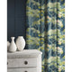 Curtains in a blue and green velvet fabric with stain resistant finish and tree design