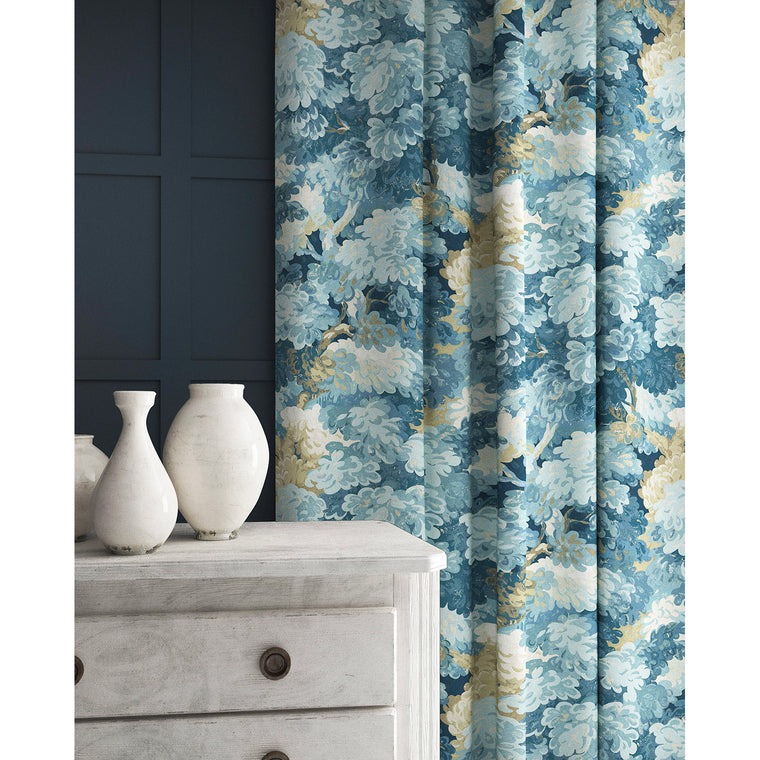 Curtains in a blue coloured velvet fabric with stain resistant finish and tree design