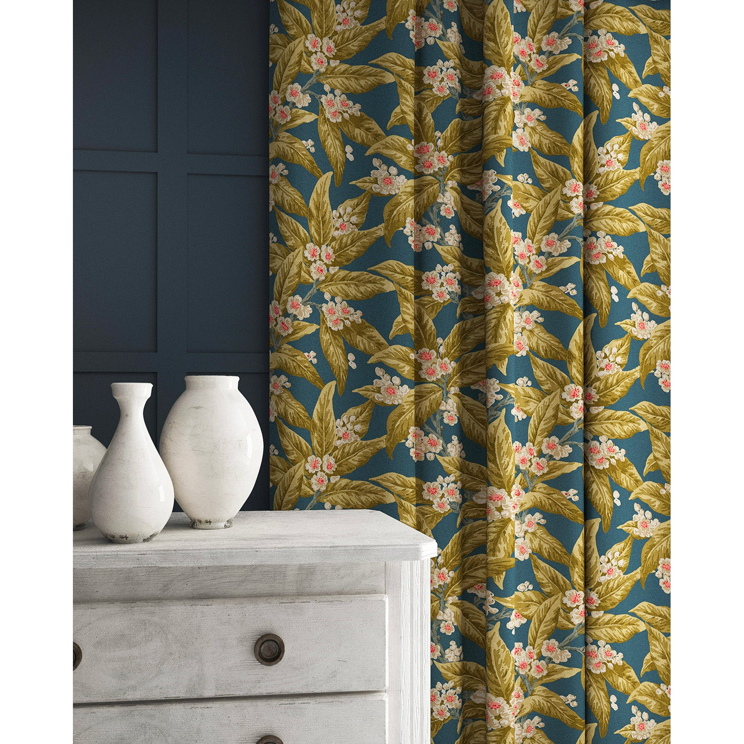 Curtains in a blue and ochre coloured velvet fabric with a leaf and blossom design and stain resistant finish