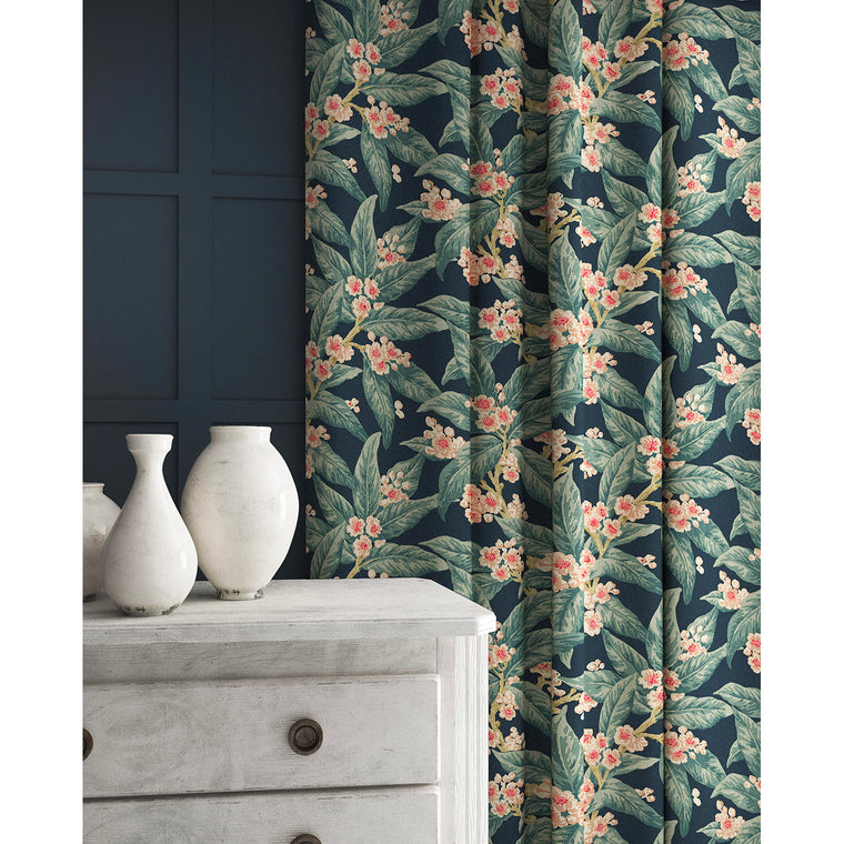 Curtains in a pink and blue coloured velvet fabric with a leaf and blossom design and stain resistant finish