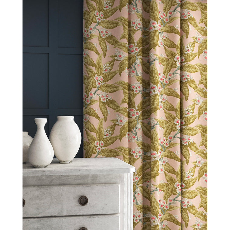 Velvet curtains in a pink and ochre coloured velvet fabric with a leaf and blossom design and stain resistant finish