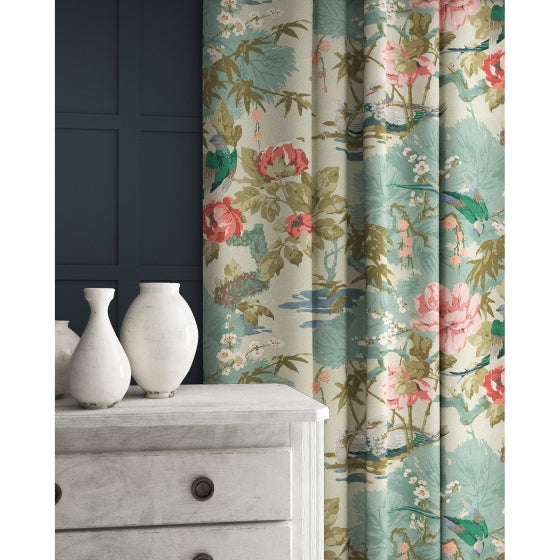 Velvet curtain in a light blue and pastel velvet upholstery fabric with floral and bird design with a stain resistant finish