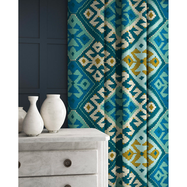 Velvet curtain in a velvet fabric with stain resistant finish and kilim design in blue tones