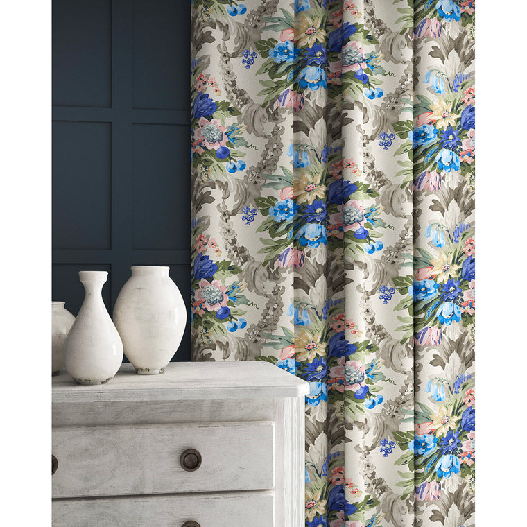 Curtains in a velvet fabric with blue and peach floral bouquet and stain resistant finish