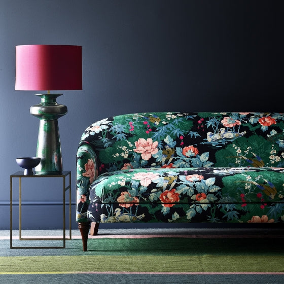 Velvet sofa upholstered in a multicoloured upholstery fabric with floral and bird design with a stain resistant finish