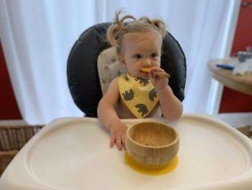 image of little girl eating from bamboo bowl- Bumbini Cloth Diaper Company