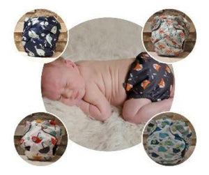 newborn baby with all in one diaper with fox prints