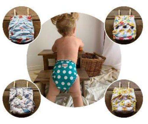 girl with polka dots diaper cover- Bumbini Cloth Diaper Company