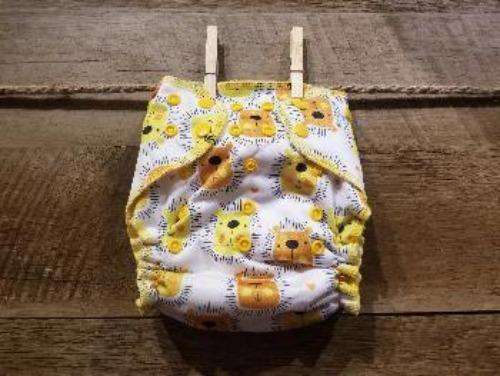 One Size AI2 Yellow Lions on White Background Diaper System - Bumbini Cloth Diaper Company