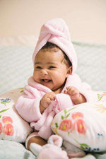 baby smiling with bathrobe and hair towel -Bumbini Cloth Diaper Company