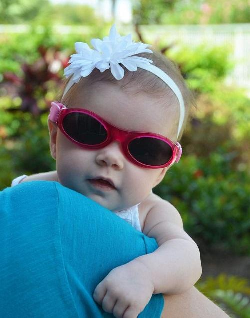 little girl wearing pink baby banz sunglasses- Bumbini Cloth Diaper Company