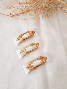WHITE AND GOLD CLIP