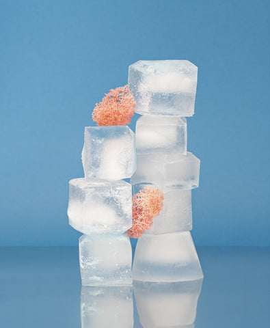 A stack of ice cubes against a blue background