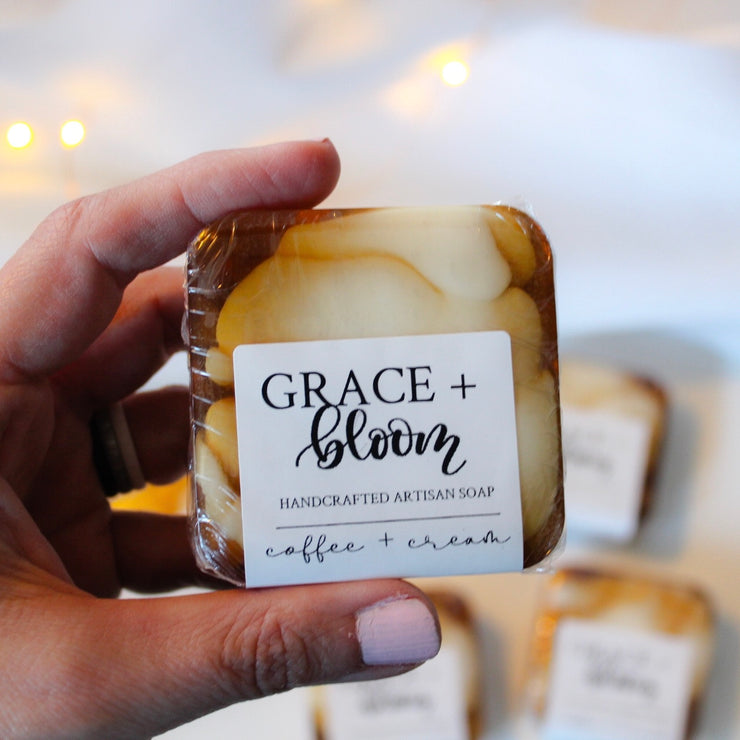 COFFEE + CREAM SOAP is smooth and moisturizing and is made with real coffee! Enriched with cocoa butter, shea butter, and mango butter for soft skin and creamy bubbles. It smells like fresh-roasted hazelnut coffee and sweet cream