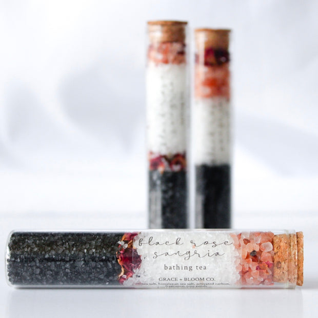 BLACK ROSE SANGRIA Bathing Tea: Scents of apple, pear, and sweet berries blend with black rose and vanilla musk. Pink Himalayan and sea salts are layered with black lava salt and red roses.