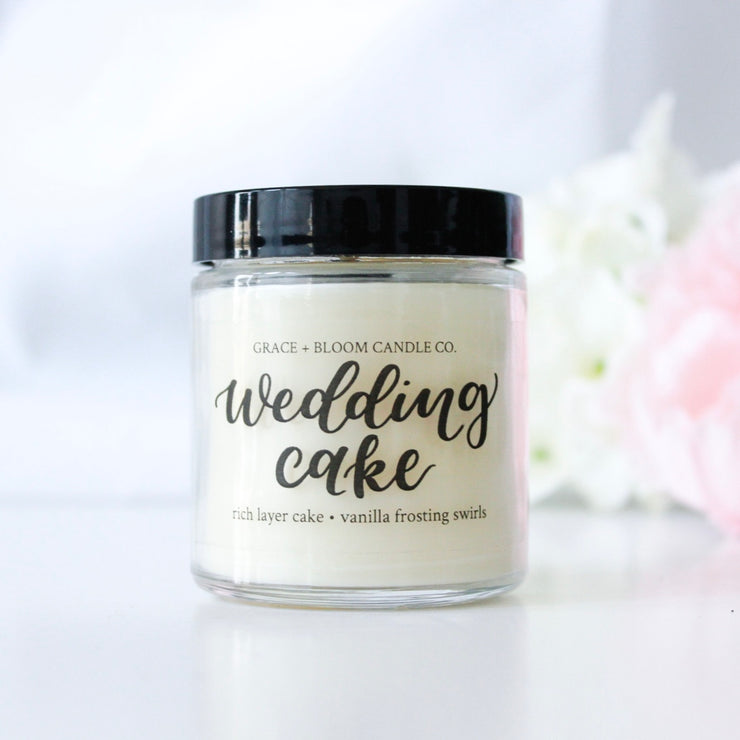 Grace + Bloom wedding candles scented in the sweet, craveable scent of rich vanilla layer cake topped with fluffy buttercream frosting swirls.