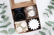 This boxed gift set has everything you need to enjoy our fun-scented soy wax melts! Ceramic melter, tea light candles, wax melts, and paper liner.