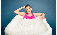 woman in ice bath for post run recovery