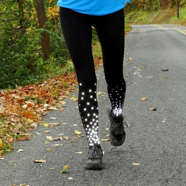 ruseen reflective running tights closeup of woman running