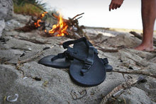 Load image into Gallery viewer, shamma sandals running shoes on rock with campfire in background