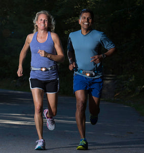 man and woman running with gomotion lighting
