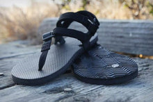 Load image into Gallery viewer, shamma sandals running ultra grip sandals resting on wooden platform