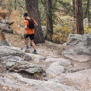 orange mud adventure pack 12l man on rocks