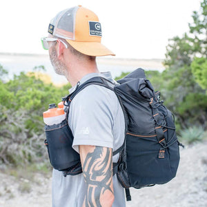 orange mud adventure pack 20l man wearing pack