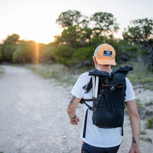 orange mud adventure pack 20l man walking