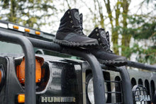 Load image into Gallery viewer, hiking shoe on top of humvee
