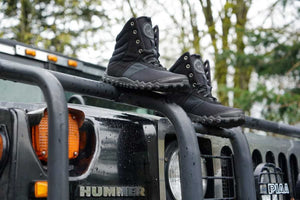 hiking shoe on top of humvee